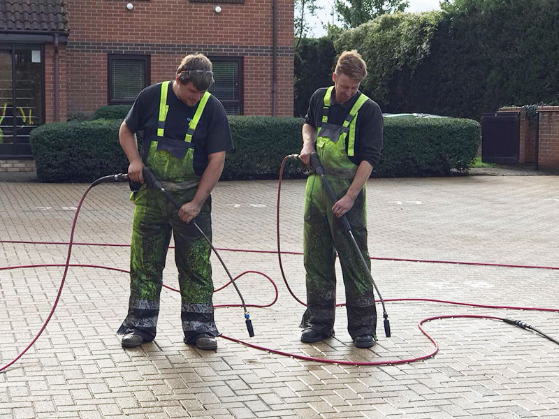 Our Team Cleaning A Brick Weave Drive